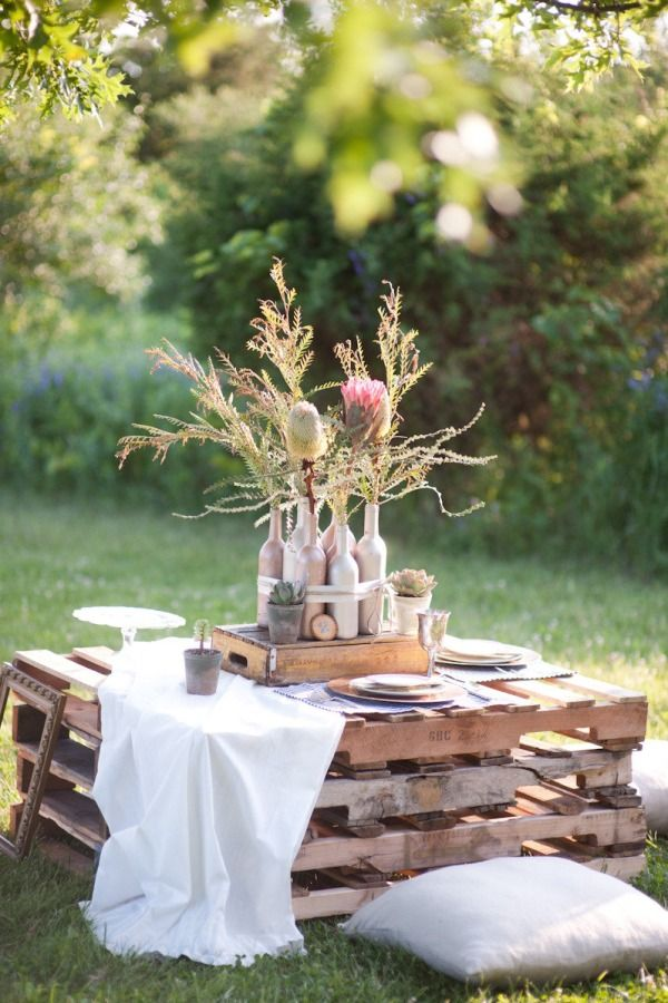 Romantic setting - Pallet picnic tables for the reception. Rustic boho chic.