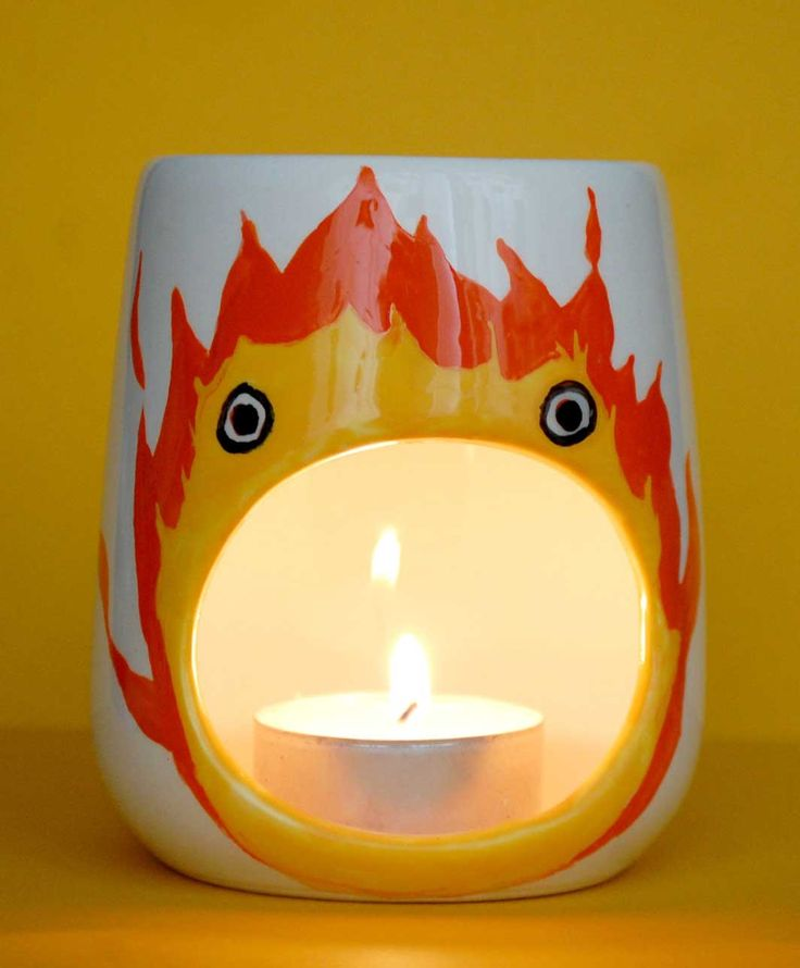 Calcifer Oil Burner <-- have you seen Howl's moving castle? If not you need to!!!