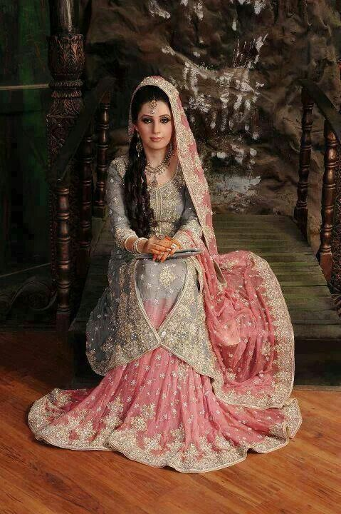 Pakistani bride in a grey and pink lehnga.