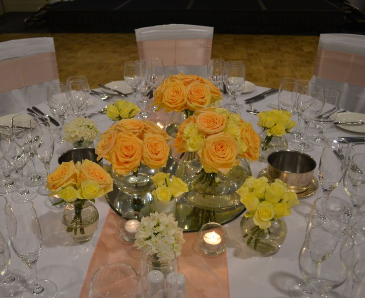 Peach florals for wedding reception guest tables. Styled by Greenstone Events.
