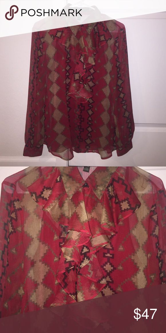 Lauren by Ralph Lauren sheer blouse Ralph lauren blouse size extra M long sleeves with button cuff. Sleeves are gathered at the cuffbutton frontfront has cascading ruffle collar textured semi sheer southwestern print in shades of tan, taupe, and black on a red background fabric and care: 100% polyester. Machine wash tumble dry. Lauren Ralph Lauren Tops Blouses