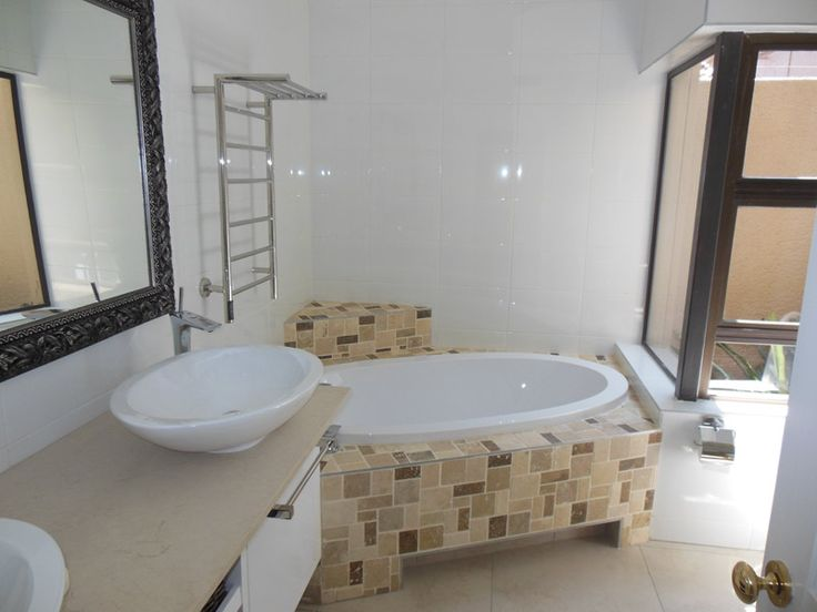 Completely new bathroom. New floor & wall tiles, cupboards, cupboard top, electrics, fittings, plumbing, cornices and painted ceiling.