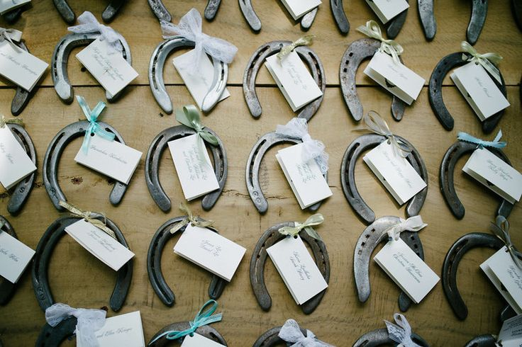 The Groom is an expert craftsman and crafted this custom milled place card holder for the adorable horse shoe seating assignments. These were a fond memory of the bride's childhood. Ellie Koleen Photography.
