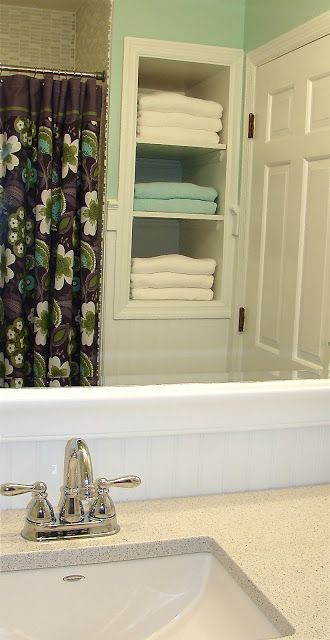 The Vintage Glitter House: Girl's Bathroom Remodel on a Budget. Remove top door cabinet to make open shelving for towels.