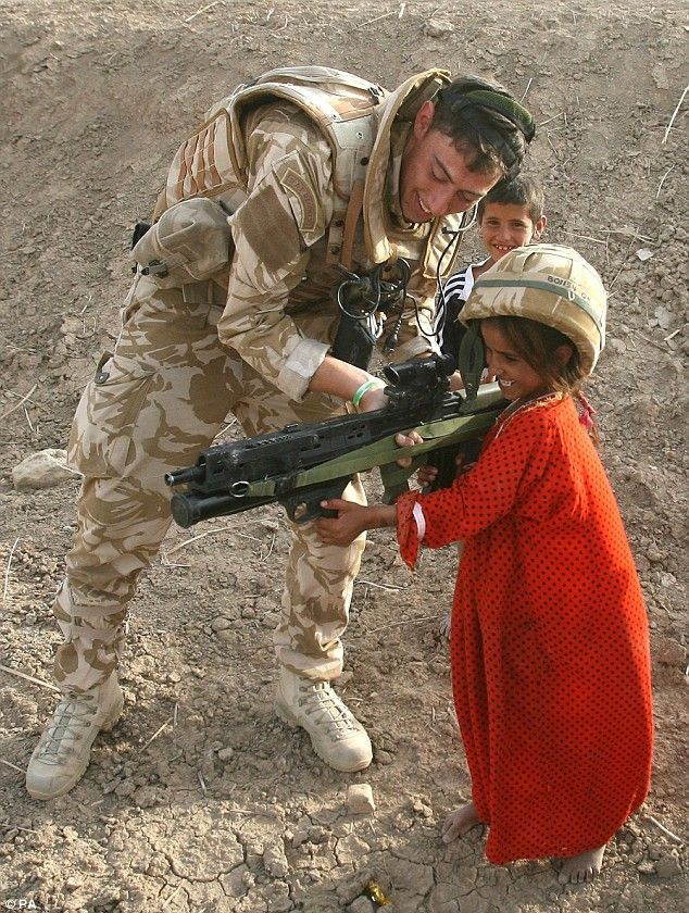 Iraq War Casualties - Football and tomfoolery: British troops lark about with Iraqi children ...