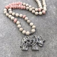 Beautiful lucky elephant pendant necklace. You will be delighted with your large silver metal elephant pendant suspended from a strand of natural wood beads complimented with coloured resin stone beads.