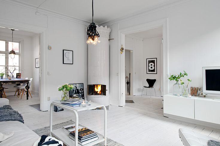 Zweedse interieurs\ Idee onthouden: bovenkant kachel toepassen op bovenkant kast. ( met Ikea plantenbak? Bovenste rand er af knippen met een metaalschaar? Dat bevestigen aan een smalle kast?)