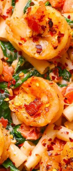Bacon and Shrimp Pasta with creamy Garlic sauce, Spinach, Tomatoes. Easy family weeknight dinner recipes.