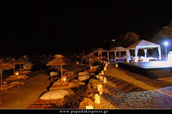 Ethnic wedding party  Keyhole View: Colored pillows and floral carpets on the sand assist in the extension of the party area until the coastal line