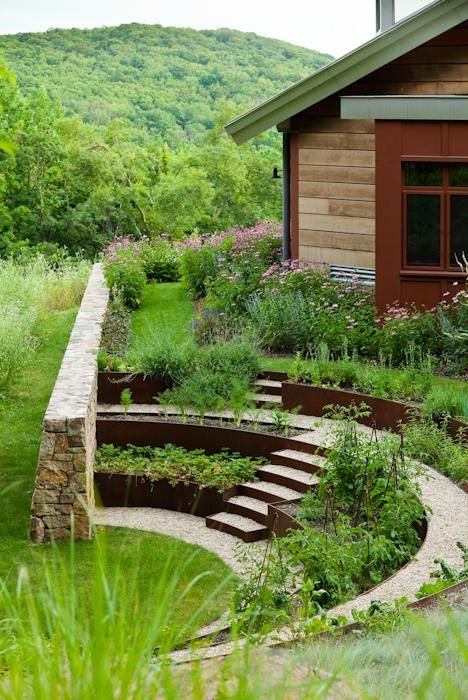 """The vegetable garden is a semicircular amphitheater of produce near the house's back door. Cor-Ten steel defines vegetable beds."" Gardenista"