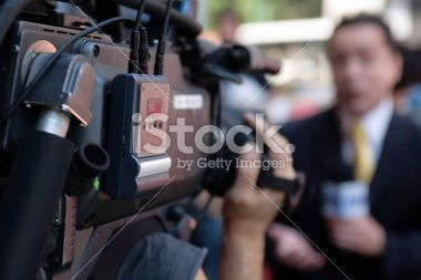 Cameraman filming a reporter Royalty Free Stock Photo