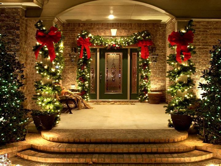 Captivating Festive Porch And Home Entrance Christmas Decor Featuring Lighted Green  Garland With Red Bow Around The Door And Lighted Garland Wrapping Porch  Column Idea.