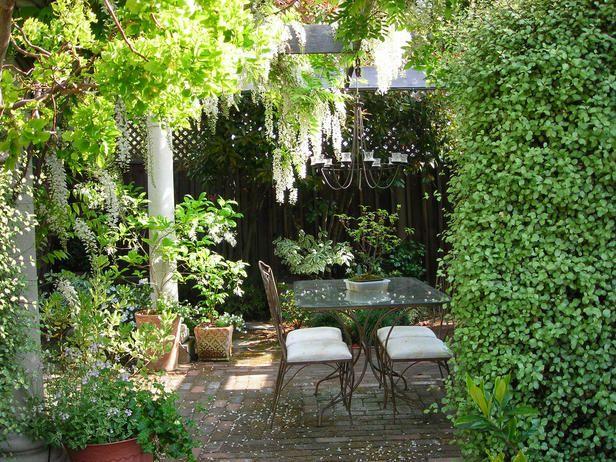 Courtyard garden with brick paviers and pillars