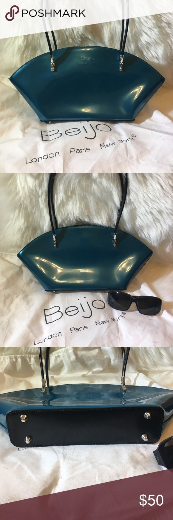 NWOT Beijo patent shoulder bag in dark teal Stylish genuine Beijo bag with silvertone hardware and feet. Features interior zip and slip pocket. Comes with care card/wallet and dust bag! Beijo Bags Shoulder Bags