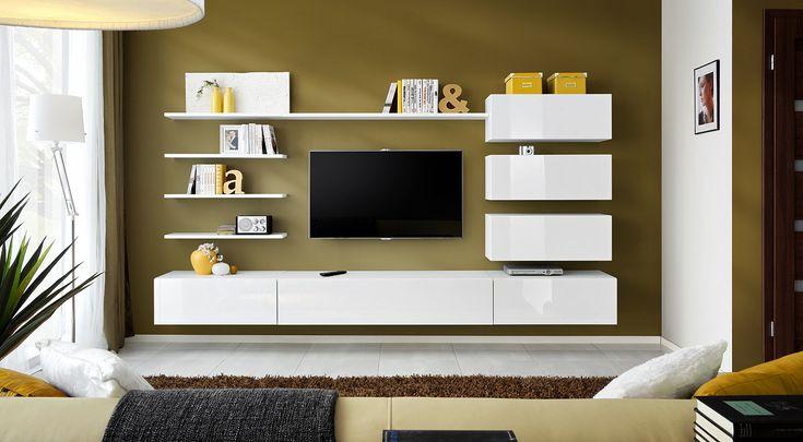 Moderná obývacia stena s jednoduchými líniami a veľkou praktickou stránkou. Zostava obsahuje skrinky s výklopnými dvierkami a poličky. Kedže nie sú na seba viazané, možete si ich umiestniť buď podľa vzoru na obrázku, alebo zapojiť fantáziu a zariadiť si obývaciu izbu podľa vlastných predstáv a potrieb. Všetky dvierka sa otvárajú dômyselným PUSH-CLICK systémom, kedy stačí jemne zatlačiť pre otvorenie alebo opätovné zatvorenie dvierok. Fronty majú vysoký PCV lesk.