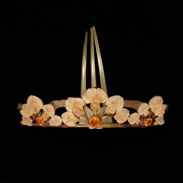 Réne Lalique  |  horn, cast glass, enamelled gold and fire opals Tiara comb, ca. 1900