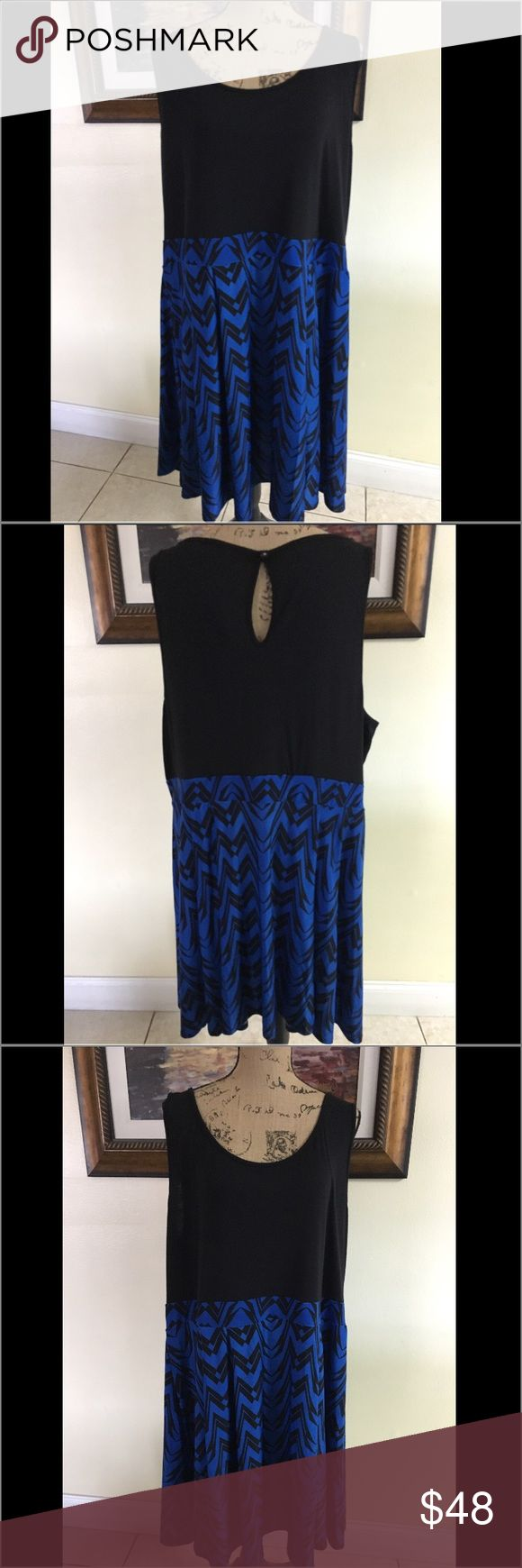 Torrid Blue Chevron Dress Torrid Blue Chevron Dress.  NWT.  Trend-right blue and black chevron stripes pattern this effortless knit tank dress. Cool, flirty and casual - we recommend wearing it everywhere this summer.  Could be worn during the day or night!  Sold out!   Features & details Polyester/spandex Wash cold; dry low Imported torrid Dresses