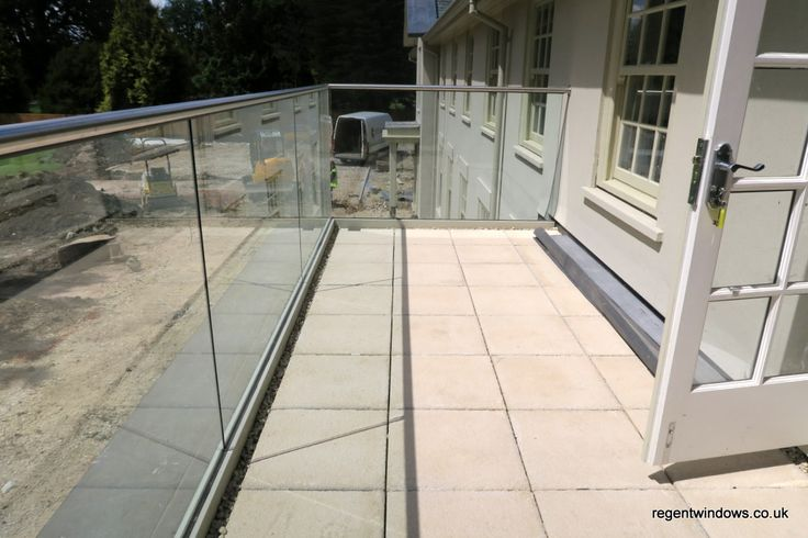 15mm thick toughened glass balustrades fitted using a patented glazing system which means no upright supports being required, stainless steel hand rail external grade