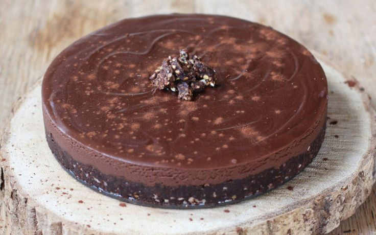 This rich and creamy tart starts with a chocolatey date crust and is topped with a smooth chocolate filling. Cocoa butter gives the filling its truffle center-like texture and after just one bite, you'll be hooked.