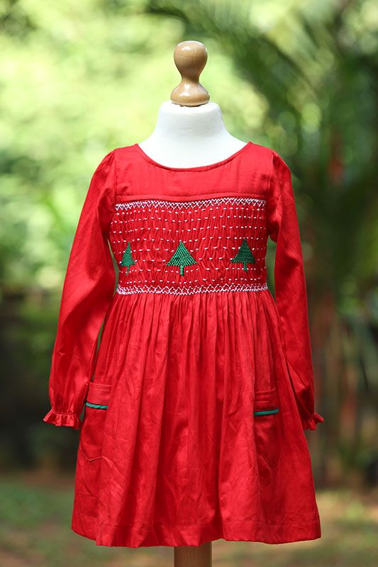 X-Mas Tree Smocked Dress - X-Mas Tree Smocked dress in scarlet red colour with a wide neck. Available for kids from 4+ years upwards. Join the excitement and fun. Christmas is here