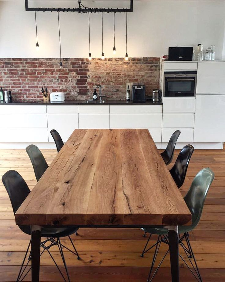 Dining table made of oak wood in industrial design …