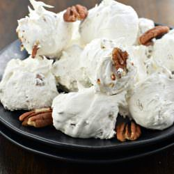 Divinity Candy is a Southern classic. Just one bite and you'll be hooked on this chewy, soft vanilla treat packed with crunchy pecans!