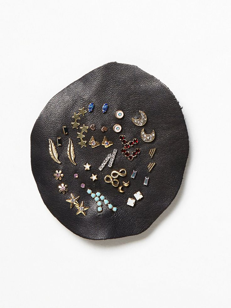 Mega Stud Set   Stones, gems, and charms! These sweet studs come in quite a collection, displayed on a leather patch. Mix and match as you like.