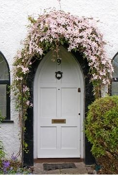 Clematis growing over doorway arch. Photo by Mark Bolton