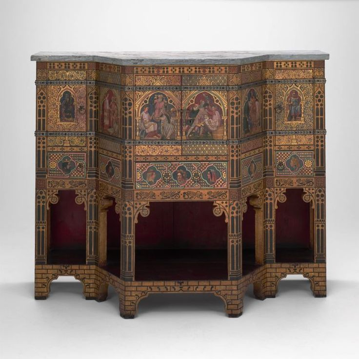 1859 British Sideboard and wine cabinet at the Art Institute of Chicago, Chicago - This piece carries clear callbacks to Medieval artwork, thus suggesting that it is a Gothic Revival piece.