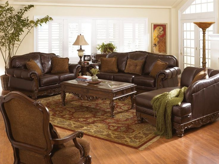 Furniture, Amazing Bright Living Room Ideas With Dark Brown Leather Sofa On  Moroccan Area Rug And Arched Framed Bay Window ~ Amazing Ashley Furniture  Living ...
