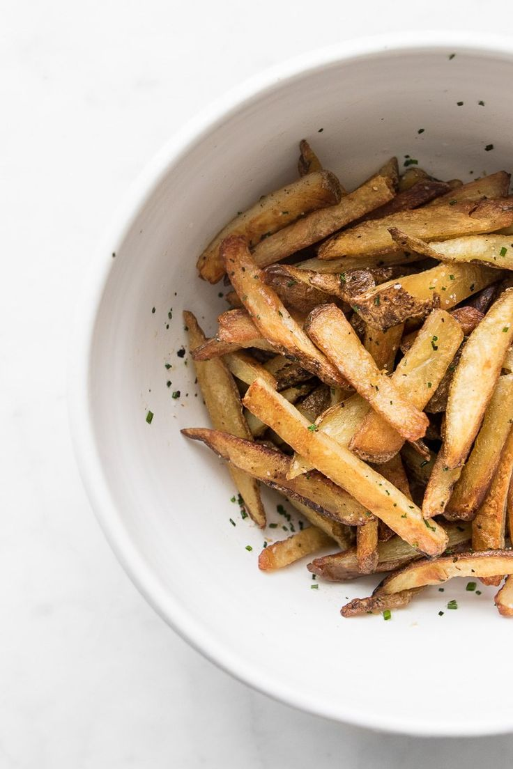 This simple and delicious recipe guarantees crispy oven baked fries every single time, and are as addictive as any takeout paper filled bag. #BeautifulFood #Fries #Potatoes #Whole30 #EasyDinner #BakedFries