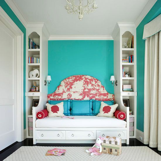 Cute child's room or guest room bed built into a small niche with functional storage.