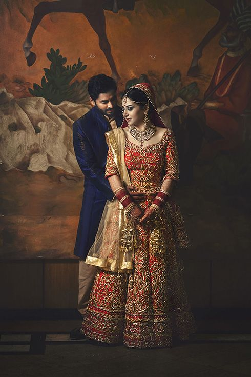 An 'ombre' silk (dyed in 2 colors), from chili red to blood red enhanced with rich yellow gold colored work all over and a net pleated skirt below. For the dupatta, a crepe one over the head and a golden color net for styling for Gunjan Sharma of WeddingSutra. #WeddingSutraP2W