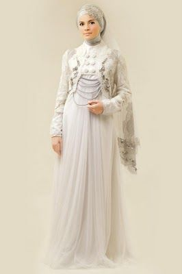 muslim wedding dresses 2011---beautiful wedding jacket, I really like the pearl chain details and the cap on her veil.