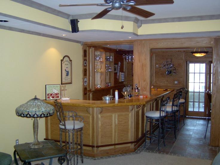 Basement With Oak Bar Setup.