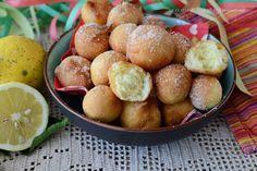 Bombette al limone dolci di carnevale veloci e golosissimi,da preparare all'ultimo minuto e servire calde calde con una spolverata di zucchero a velo.Sempli