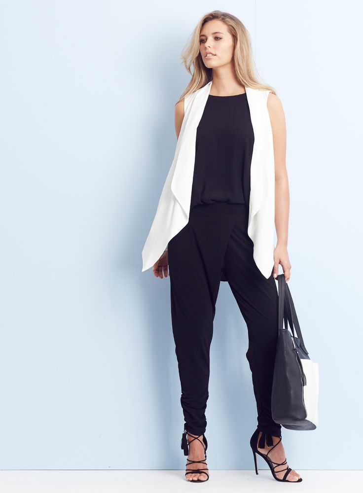 OFFICE TO EVENING / Simplify your day with effortless office to drinks looks. Wrap front ankle ruching details update the black pant this season.