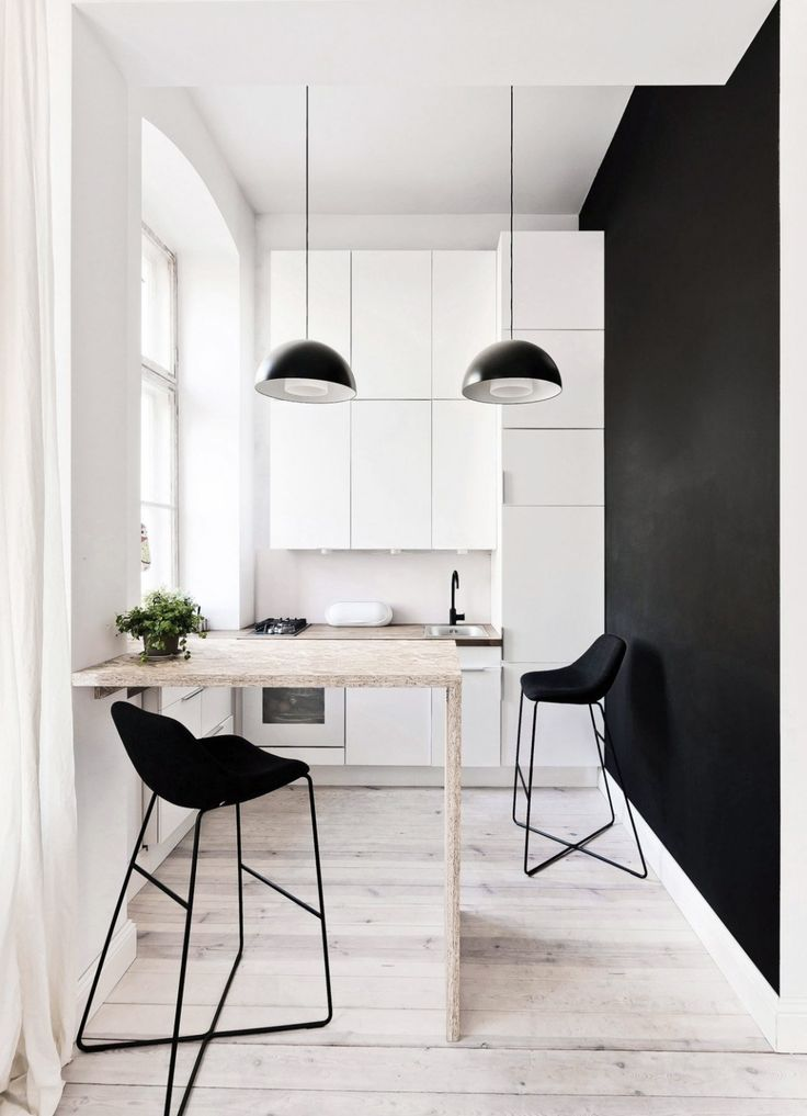 monochrome kitchen with wood floor  | www.homeology.co.za   #kitchendecor #kitchen #decor #interiors