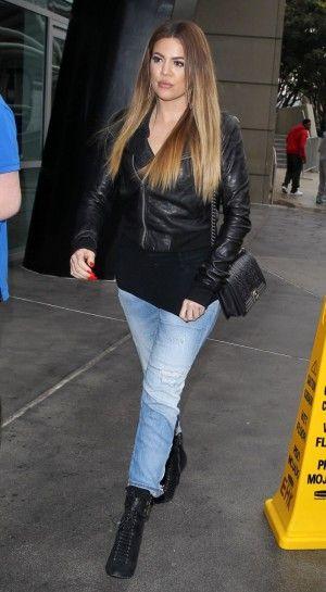 Khloe Kardashian wearing Rick Owens Washed Bomber Leather Jacket and Chanel Boy Pre-Fall 2013 Bag