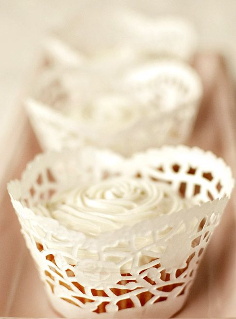 Free lace cupcake wrapper template made with paper doilies...