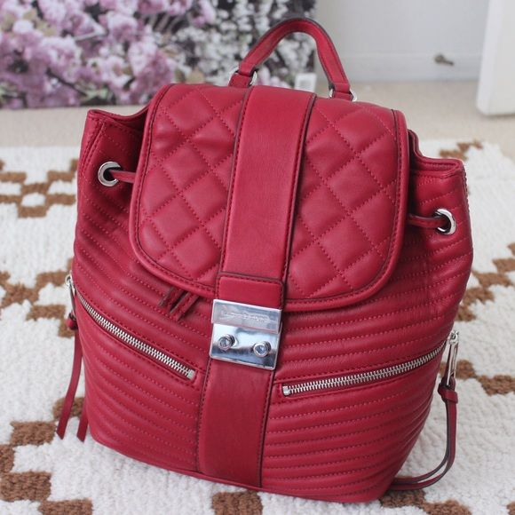 """Brand NewMichael Kors Quilted Backpack """"Elisa"""" Price is absolutely FIRM❤️BRAND NEW WITH TAGS ATTACHED❤️100% Authentic Michael Kors """"Elisa"""" Backpack in Cherry/Silver  / MSRP $398+tax. A feminine take on a sporty silhouette, this Elisa backpack is the epitome of casual glamour. It's detailed with luxe quilted stitching for tactile appeal and illuminated with high-shine hardware for a gilded finish. My price is firm for this beautiful baby!  No trades/offers you'll be declined. Michael Kors…"""