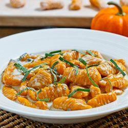 Pumpkin gnocchi in an creamy gorganzola sauce. Umm @Christin Willis.. yum.