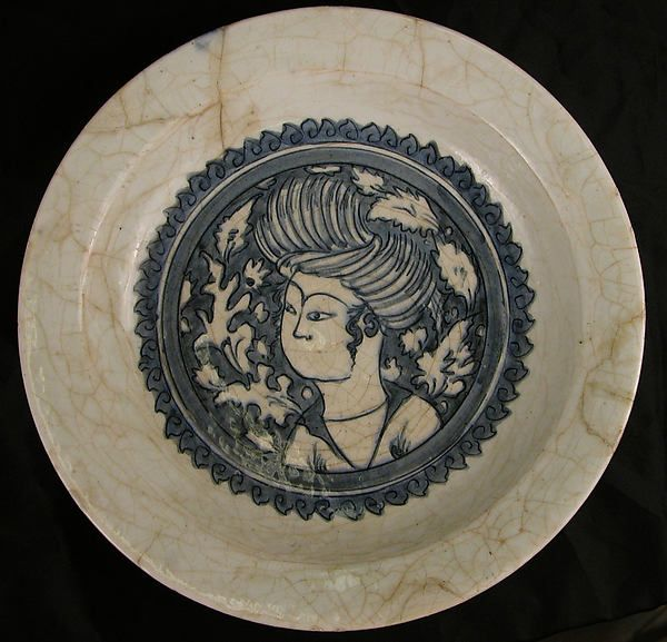 Dish with a Portrait of a Man Date: 17th century Geography: Northwestern Iran Culture: Islamic Medium: Stonepaste; painted in blue under transparent glaze (Kubachi ware) Dimensions: H. 2 1/2 in. (6.4 cm) D. 13 5/8 in. (34.6 cm)