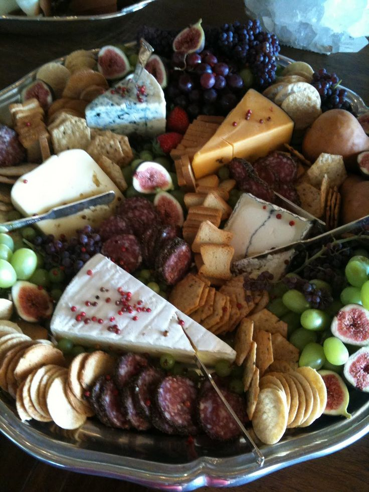 Maximum Impact Cheese Platter: For all events a fruit/cheese platter is always elegant! Try to always use cheese in their natural state (i.e., don't cut up the cheeses) with a few little knives to cut. The best fruits for price, taste, & mostly presentation is grapes (champagne grapes are elegant), kiwi, sliced starfruits, & figs. Arranged beautifully!