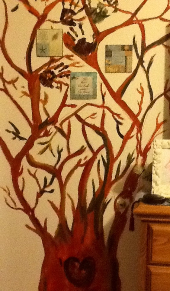 This is is corner of our bedroom, & I call it our family tree! The leaves are going to be members of our families hand prints... I can reach out & touch them every night before I sleep!