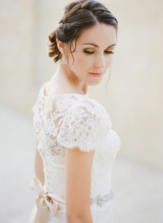 Pretty lace detail, belt and satin ribbon on this dress from Samantha Wynne Bridal Collection (via Polka Dot Bride).