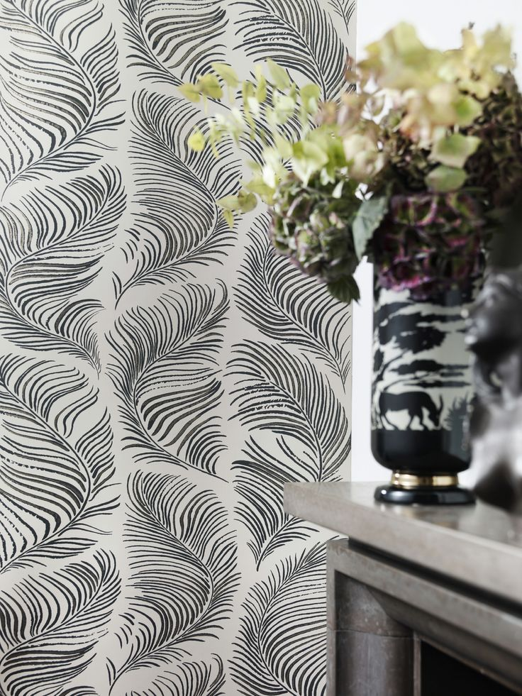 The feather plumes are reminiscent of bubbly champagne, art deco graphics, luxury and frivolity.  Design: Karolina Kroon
