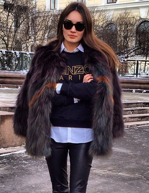 Kenzo sweater and fur jacket.