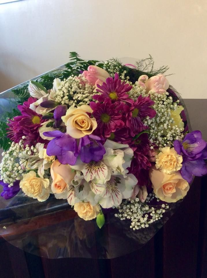 A nice spring mix of flowers with freesia, roses, miniature carnations and alstroemeria.