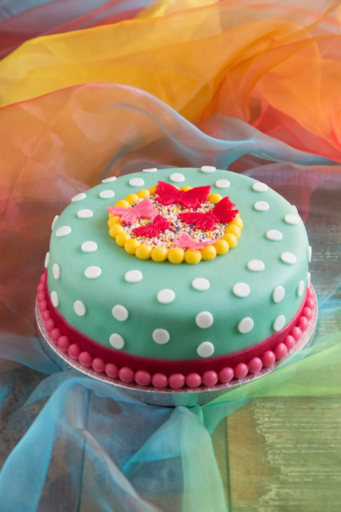 Colorful dotted cake with butterflies decoration